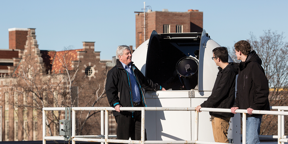Dr. Peter Gonthier and Calvin Gentry Class of 2018, and Josiah Brouwer Class of 2018 on the roof of an observatory.